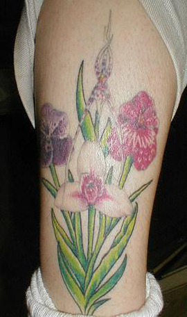 Free and Cool flowers tattoos on legs photos. Flower Wrist Tattoos pictures
