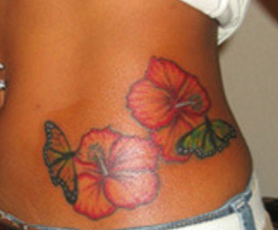 lotus flower tattoos; hawiian flower tattoos; lilly flower tattoos;