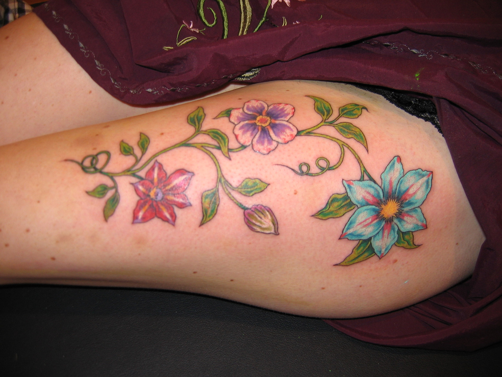 Looking for unique flower tattoos star tattoos design for Flower tattoos on hand