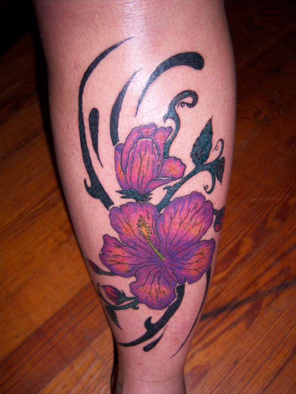 Tropical flower tattoos are often combined with a Hawaiian band and are