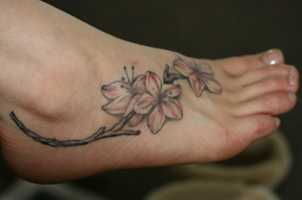 flower tattoos on the foot