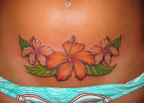 tattoos on stomach for women. lower abdomen tattoos.